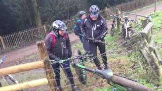 Three blokes trying to remove a fat bike from an electric fence